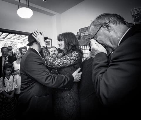 Mother of groom hugs her son while the father wipes away tears - Jewish Wedding - Congregation Beth Israel - Wedding