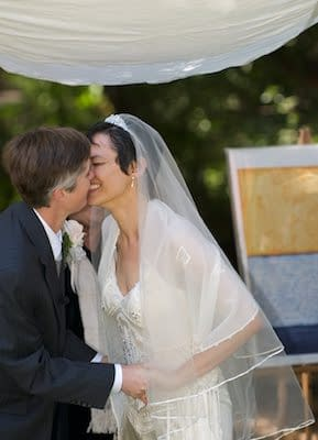 Brides kiss under Chuppah - UC Berkeley Faculty Club - Wedding