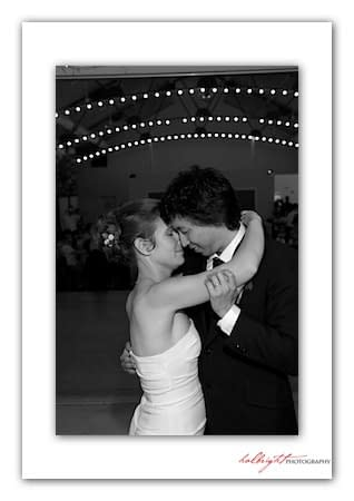 Bride and Groom have their first dance under string lights - Camp Arroyo Wedding