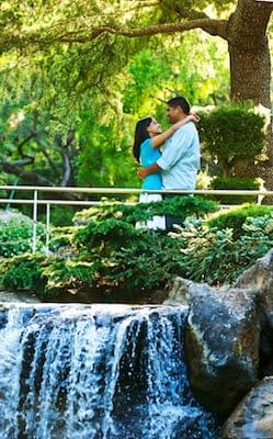 Engagement Portrait of Indian Couple above a waterfall at Gilroy Gardens