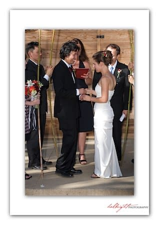 Bride and Groom stand together under the chuppah - Camp Arroyo Wedding