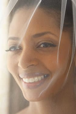 Smiling black bride is photographed through her veil | oakland wedding - wedding photography