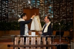 Bar Mitzvah and his father undress the torah at Temple Peninsula Sholom Burlingame