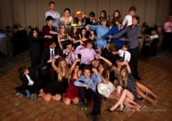 Exceptional San Francisco B'nai Mitzvah Photographer - A group of people sitting in front of a crowd - San Francisco