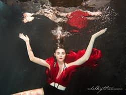 Lizzie Gunst poses underwater in red