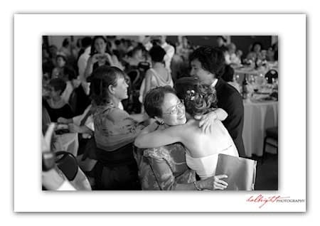 Mother of the Groom hugs the bride - Camp Arroyo Wedding
