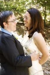 GBLT couple connects with each other during a portrait session on their wedding day at Mills College, Oakland, California